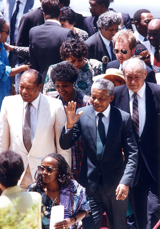 . June 1990: Nelson Mandela, Mayor Tom Bradley and John Ferraro on Spring Street at Los Angeles City Hall.  Daily News file photo