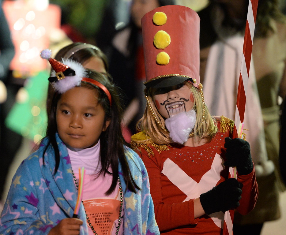 . The 60th annual Daisy Avenue Parade in the Wrigley neighborhood Saturday, December 13, 2013, in Long Beach, CA.  Girls with the Girls Scouts of Greater Los Angeles march dressed as characters from the Nutcracker. Photo by Steve McCrank/DailyBreeze