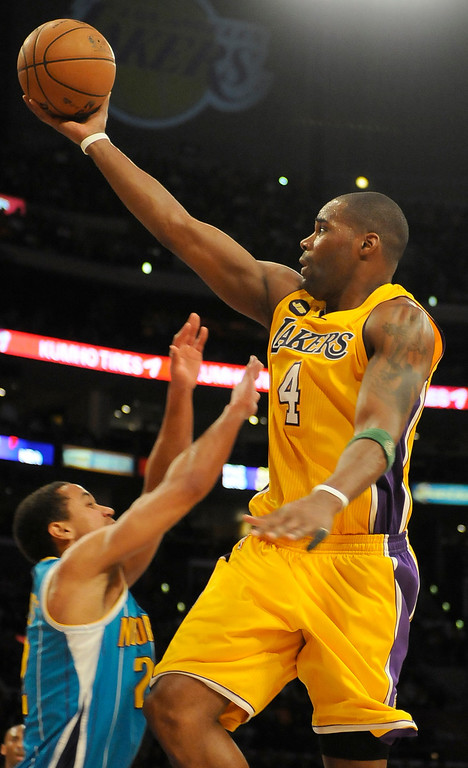 . Lakers#4 Antawn Jamison drives to the hoop in the 4th quarter. The Lakers defeated New Orleans Hornets 104-96 in a game played at Staples Center in Los Angeles, CA 4/9/2013(John McCoy/Staff Photographer