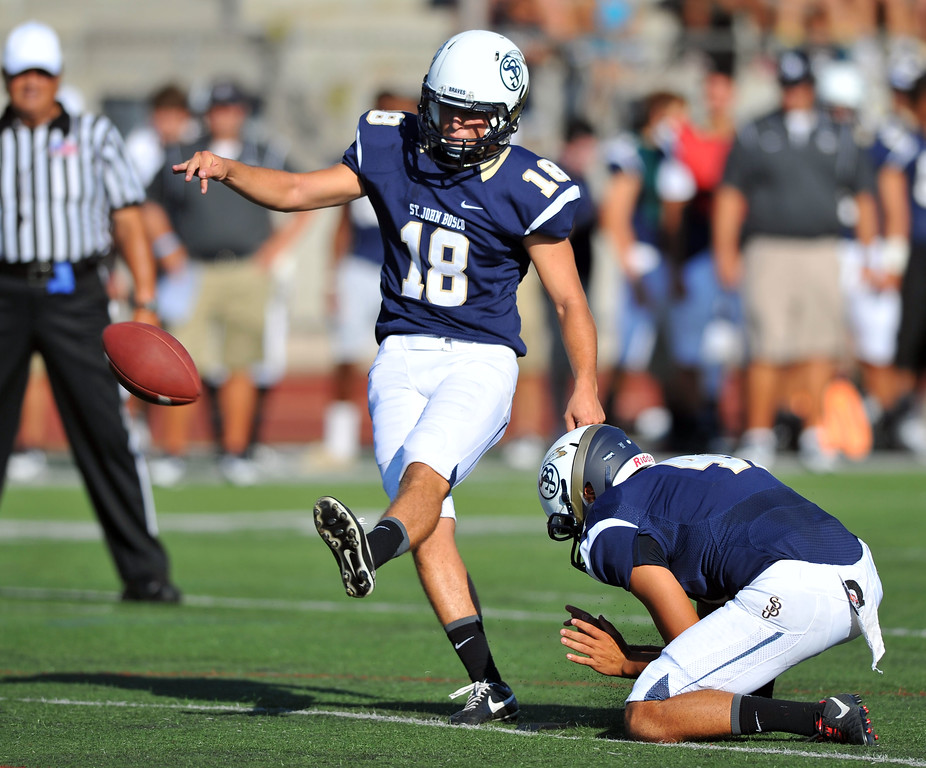 . St. John Bosco football takes on Chandler, Airzona as part of the Mission Viejo Classic in Mission Viejo, CA on Saturday, September 14, 2013. St. John Bosco won 52-31.  Bosco\'s Reid Budrovich chips in a PAT. (Photo by Scott Varley, Press-Telegram)