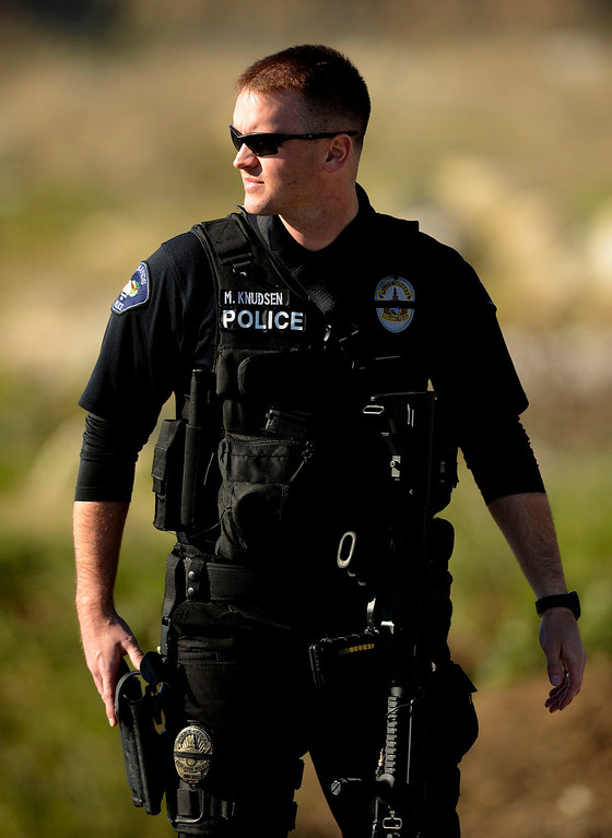 . Redlands Police Redlands Police Officer K. Knudsen stands guard at a blockade along Highway 38 and Bryant Street near the Mill Street Ranger Station west of Yucaipa February 12, 2013.  Authorities believe that they exchanged gunfire with fugitive Christopher Dorner in the Angles Oaks area of the San Bernardino National Forest.  Fish and Game officers spotted a man fitting the description of Dorner driving a white pick-up, and two San Bernardino County Sheriff Deputies exchanged gunfire with him.  Authorities believe Dorner is holed up in a cabin on Glass Road and Highway 38.  GABRIEL LUIS ACOSTA/STAFF PHOTOGRAPHER.