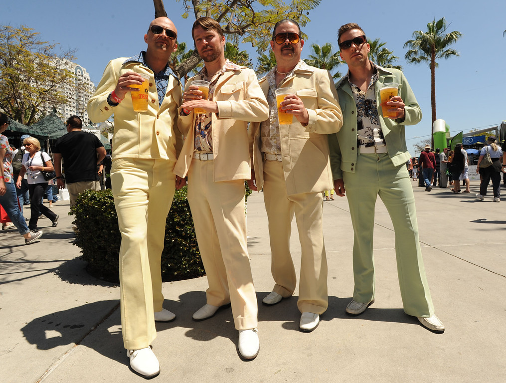 . Long Beach, Calif., -- 04-20-13-    From  left to right, Brett Seaton, Nathan Lamar, Jon Lee and  Jacob Lamar are members of the National Institute for the Preservation of Leisure Suits ( N. I. P. L. S  ) Saturday at the 39 Annual Toyota Grand Prix of Long Beach.   Stephen Carr/  Los Angeles Newspaper Group