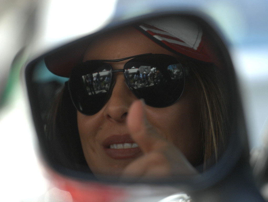 . 4/19/13 - Kate del Castillo gives a thumbs up before the Friday morning practice of the Toyota Pro/Celebrity race at the 39th Annual Toyota Grand Prix of Long Beach. Photo by Brittany Murray / Staff Photographer