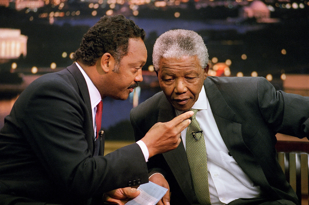. Rev. Jesse Jackson leans over to talk to African National Congress President Nelson Mandela prior to the taping of Jackson?s ?Both Sides? show at CNN studios in Washington Saturday, Sept. 25, 1993. The show will be broadcast 9 p.m. EDT Saturday. (AP Photo/Shayna Brennan)