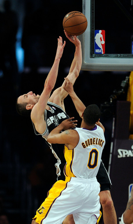 . The Spurs\' Manu Ginobili #20 shoots as the Lakers\'  Andrew Goudelock #0 defends during game four of their NBA Western Conference playoffs at the Staples Center Saturday, April 28, 2013. The Spurs beat the Lakers 120-89. (Hans Gutknecht/Staff Photographer)