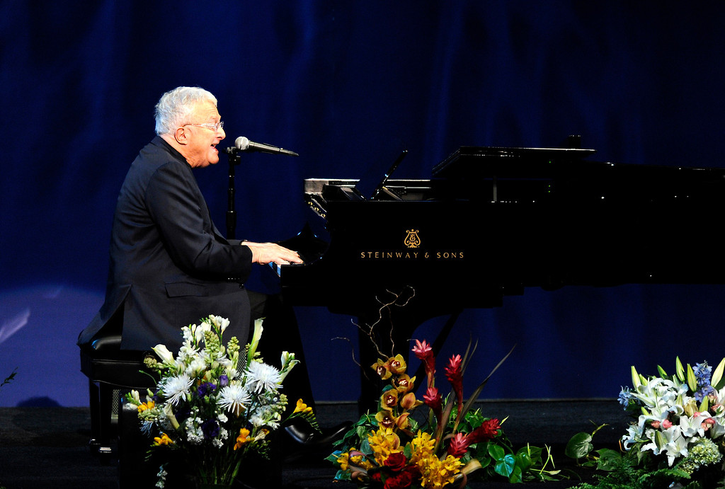 ". Randy Newman sings ""You Got a Friend in Me\"" at the Jerry Buss Memorial Service at Nokia Theatre, Thursday, February 21, 2013. (Michael Owen Baker/Staff Photographer)"
