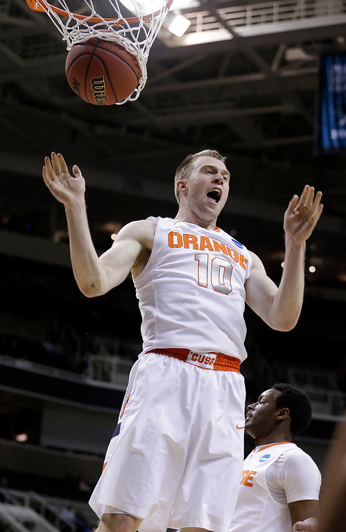 . Syracuse guard Trevor Cooney (10) yells after dunking against Montana during the second half of a second-round game in the NCAA college basketball tournament in San Jose, Calif., Thursday, March 21, 2013. Syracuse won 81-34. (AP Photo/Jeff Chiu)