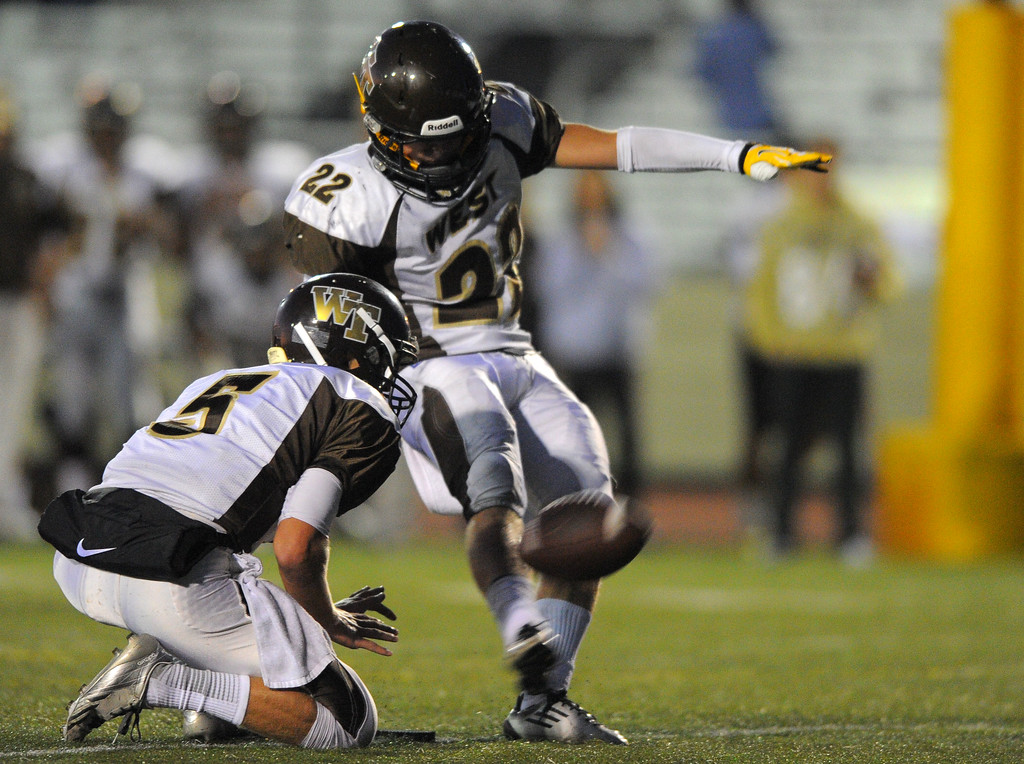 . West High takes on Torrance in a non league football game at Zamperini Stadium in Torrance, CA on Thursday, September 12, 2013. West\'s Denver Silverlake kicks a PAT. (Photo by Scott Varley, Daily Breeze)