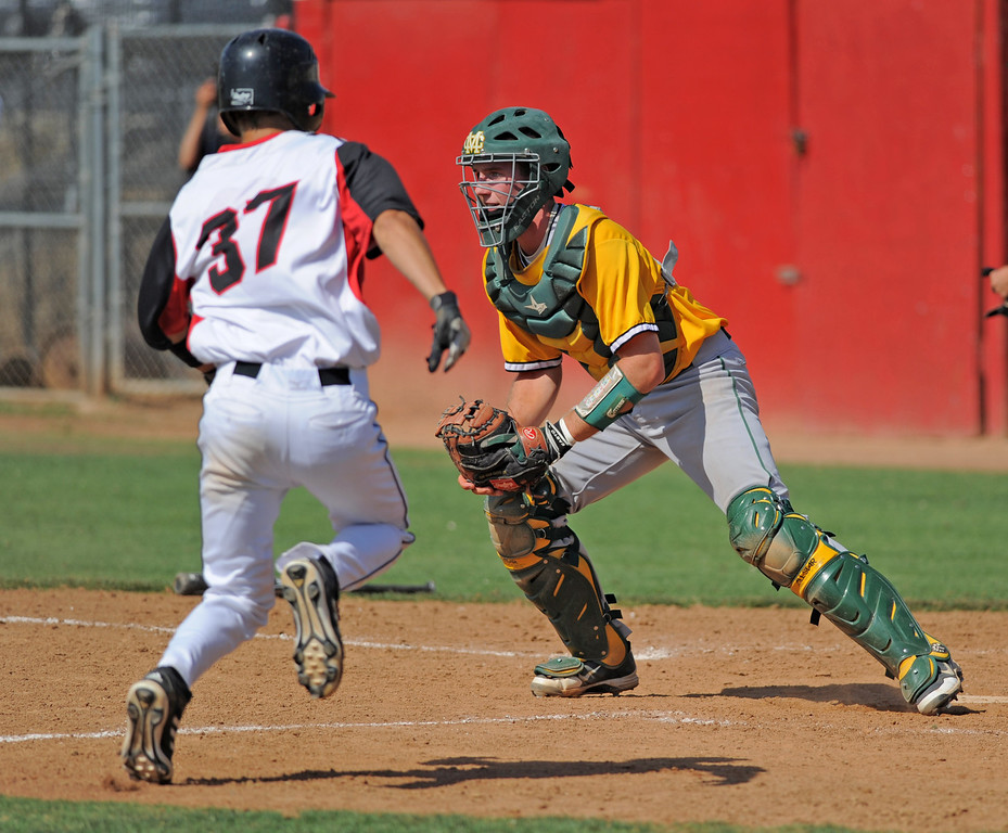 . 05-28-2013-( Sean Hiller/LANG) Mira Costa beat Elsinore 5-3 in Tuesday\'s CIF Southern Section Division III semifinal at Elsinore High School. Austin Henning awaits the ball.