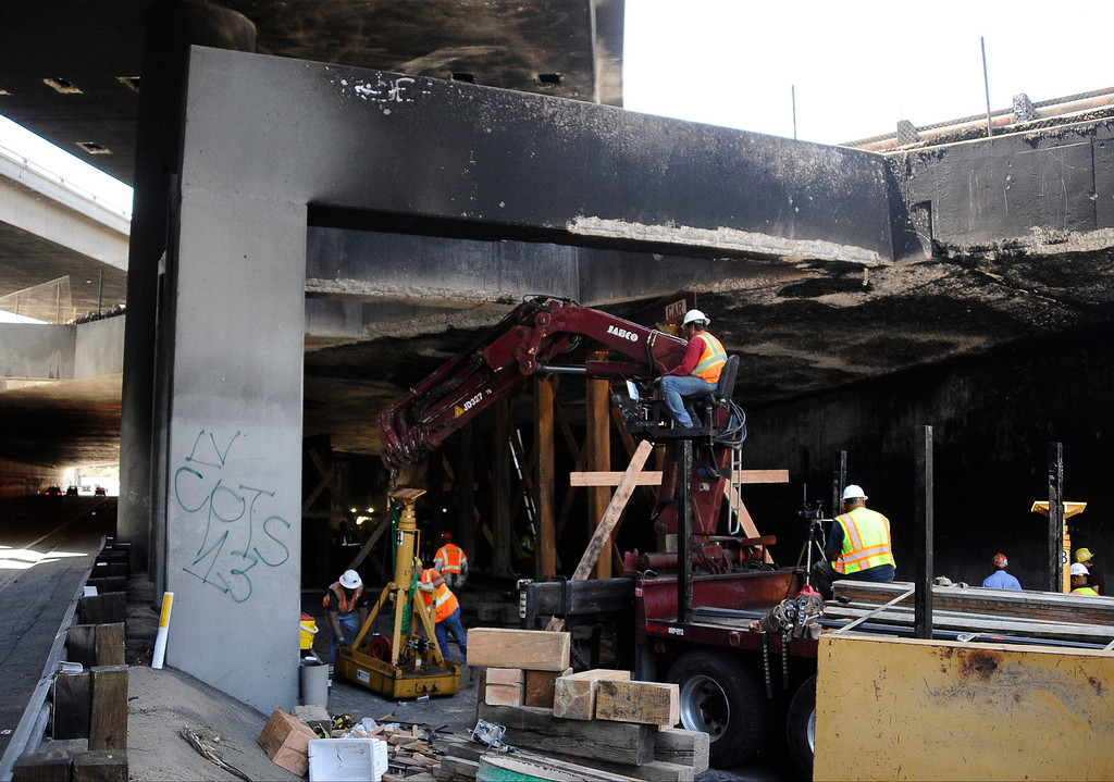 . Los Angeles CA. July 15,2013. Cal-Trans works work on doing vertical shoring up with large meal beams in the tunnel were a fuel tanker rolled over and caught fire Saturday. The fire did major damage to the concrete and will take some time for repairs.  Photo by Gene Blevins/LA Daily News