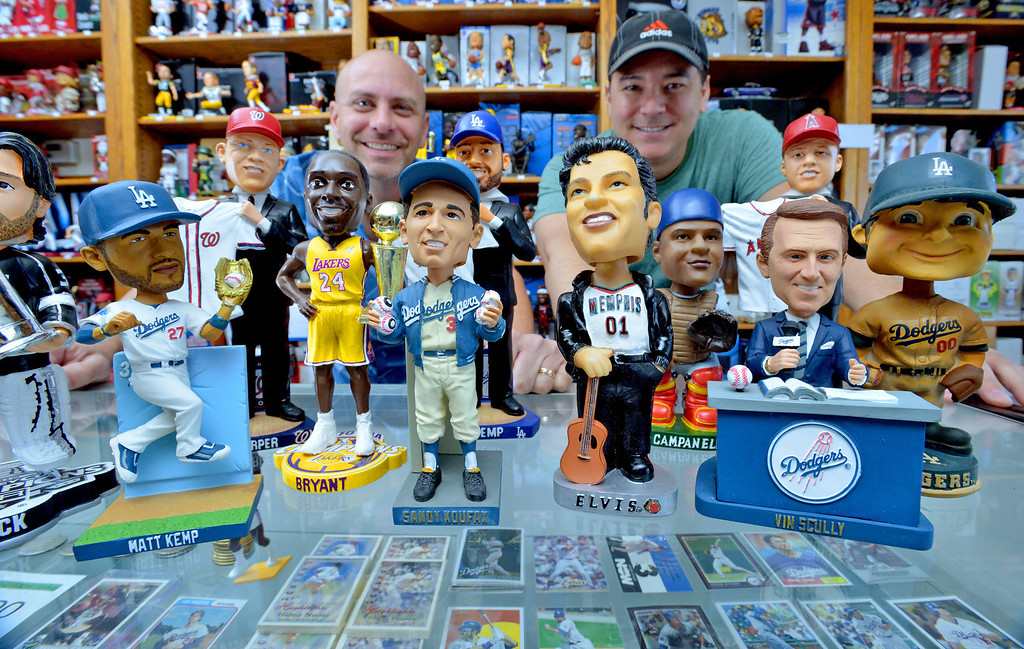 . 04-26-2013-(LANG Staff Photo by Sean Hiller)- David Perahia, left, and Kevin Kong have the world\'s biggest bobblehead store in Lomita called Baseball Cards and Bobbleheads Inc.