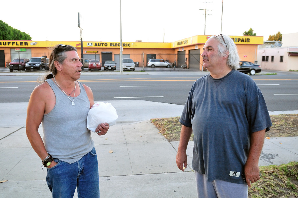 . Tim Grobaty meets his #1 fan, Alfred Esquivel, on the street outside the El Capitan Motor Inn. Esquivel\'s girfriend is a resident of the motel.Photo by Thomas Wasper for the Press Telegram