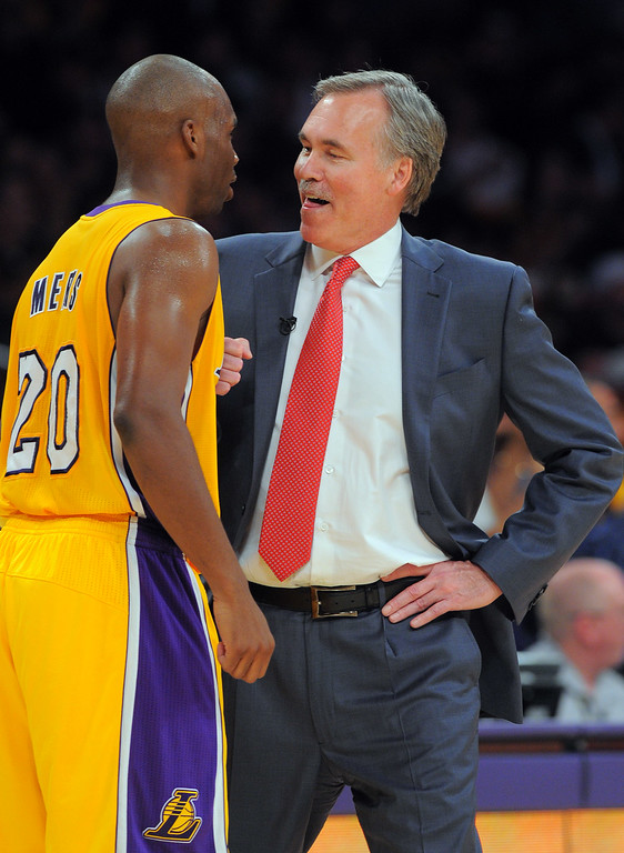. Lakers coach Mike D\'Antoni celebrates with Jodie Meeks during a timeout in the NBA season opener between the Lakers and Clippers at Staples Center in Los Angeles, CA on Tuesday, October 29, 2013.  Lakers won 116-103. (Photo by Scott Varley, Daily Breeze)