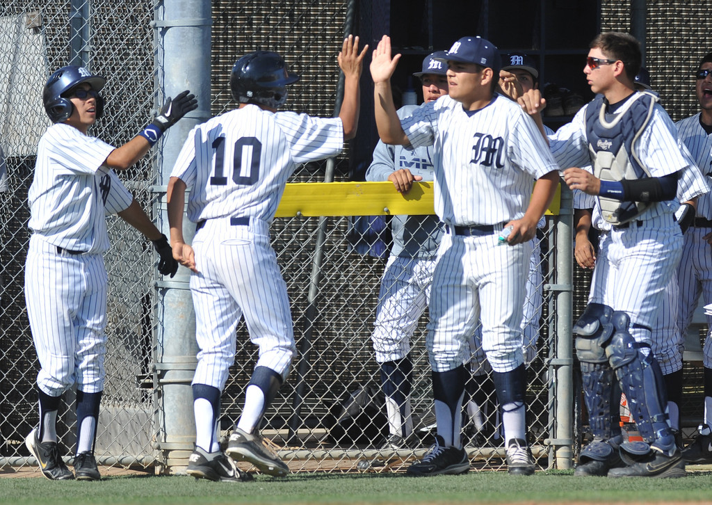 Description of . Montebello's Jose Aparicio (#10) is congratulated after scoring as they play Alhambra in their Almont League baseball game at Montebello High School in Montebello  on Friday April 19, 2013. (SGVN/Staff Photo by Keith Durflinger)