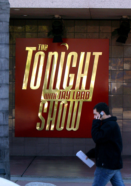 ". A man walks by the NBC studios, in Burbank, Calif., where ""The Tonight Show Starring Johnny Carson,\"" was taped, Sunday, Jan. 23, 2005. Carson, the quick-witted \""Tonight Show\"" host who became a national institution putting his viewers to bed for 30 years with a smooth nightcap of celebrity banter and heartland charm, died Sunday. He was 79. \""The Tonight Show with Jay Leno\"" has since taken over.   (AP Photo/Stefano Paltera)"