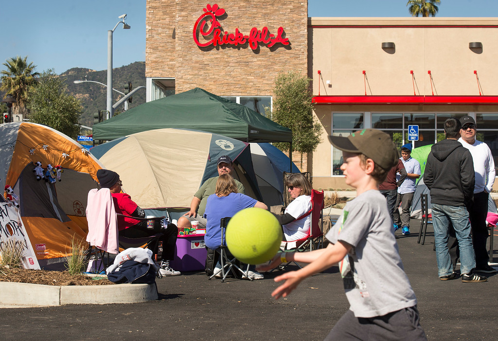 Description of . Lemuel Hill, 6, of Long Beach passes time playing four square while Chick-fil-A contestants camp out at the company's new Azusa location to receive 52 free-meal coupons Feb. 20, 2013.  Contestants waiting for the day and staying overnight are treated to games and free meals.  (SGVN/Staff photo by Leo Jarzomb)