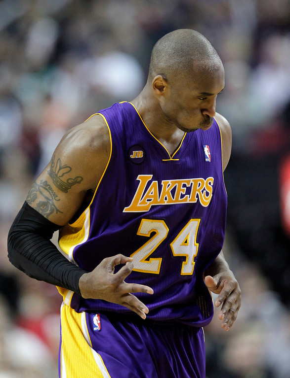 . Los Angeles Lakers guard Kobe Bryant signals after scoring a three-point shot during the second half of an NBA basketball game against the Portland Trail Blazers in Portland, Ore., Wednesday, April 10, 2013.  Bryant scored 47 points as the Lakers won 113-106.(AP Photo/Don Ryan)