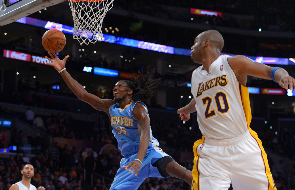 . Nuggets\' Kenneth Faired scores against Lakers Jodie Meeks at the Staple Center in Los Angeles, CA on Sunday, January 5, 2014. 2nd half. Denver Nuggets beat the Lakers 137-115.  (Photo by Scott Varley, Daily Breeze)
