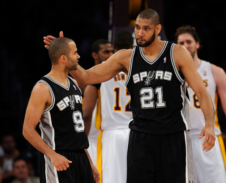 . The Spurs\' Tim Duncan #21 gives Tony Parker 9 a pat on the head during game four of their NBA Western Conference playoffs against the Lakers at the Staples Center Saturday, April 28, 2013. The Spurs beat the Lakers 120-89. (Hans Gutknecht/Staff Photographer)