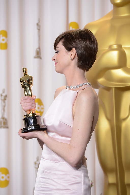 """. Anne Hathaway accepts the award for best actress in a supporting role for \""""Les Miserables\"""" backstage at the 85th Academy Awards at the Dolby Theatre in Los Angeles, California on Sunday Feb. 24, 2013 ( David Crane, staff photographer)"""