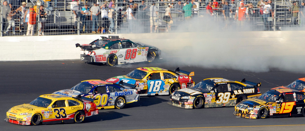 . NASCAR driver Dale Earnhardt, Jr. (88) crashes into the wall during the Sylvania 300 auto race at New Hampshire Motor Speedway in Loudon, N.H., Sunday, Sept. 20, 2009.(AP Photo/Sandy Macys)