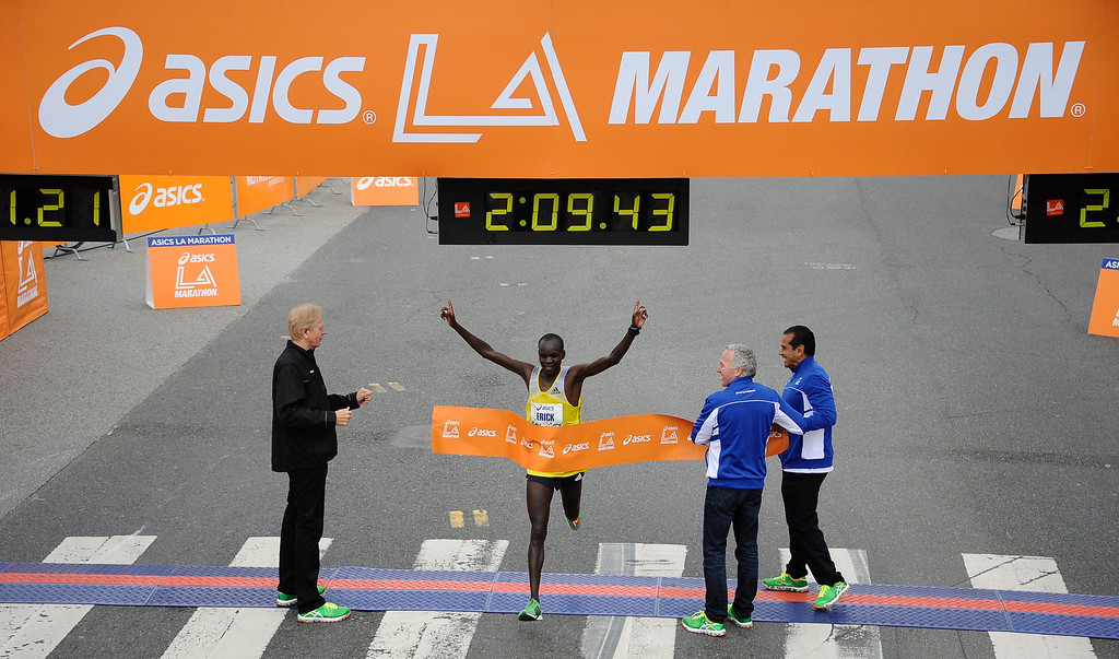 . Kenya\'s Erick Moses is the first man to cross the finish line during the 2013 LA Marathon. Santa Monica March 17,2013. Los Angeles Photo by Gene Blevins/LA DailyNews