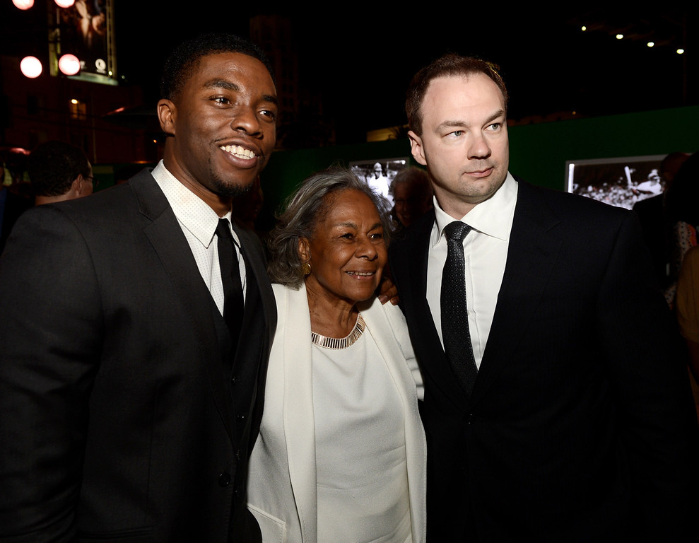Description of . LOS ANGELES, CA - APRIL 09:  (L-R) Actor Chadwick Boseman, Jackie Robinson's widow Rachel Robinson and producer Thomas Tull pose at the after party for the premiere of Warner Bros. Pictures' and Legendary Pictures'