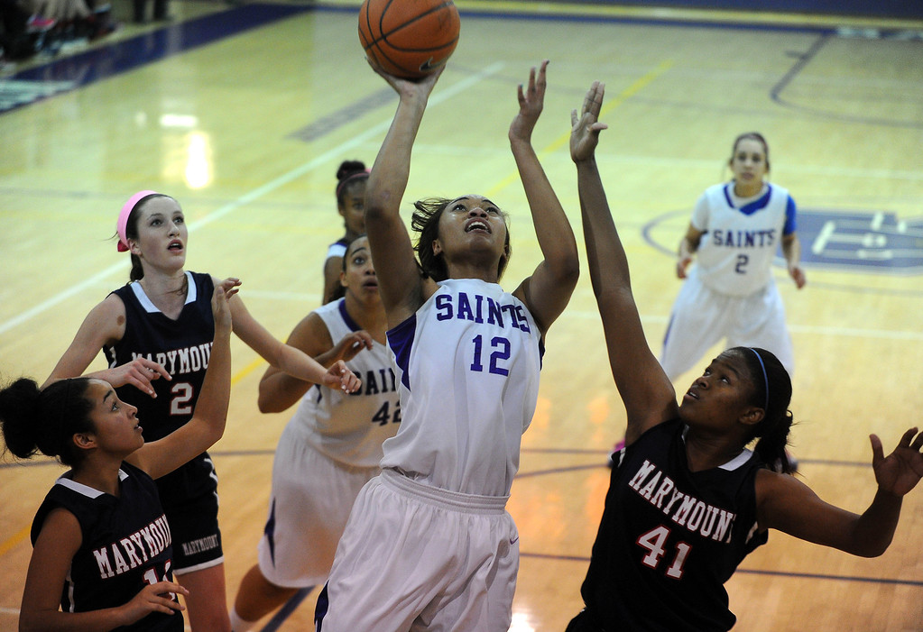 . LONG BEACH - 02/14/13 - (Photo: Scott Varley, Los Angeles Newspaper Group)  CIF-SS Div 4AA girls basketball playoff between Marymount Sailors and host St. Anthony Lady Saints. Kendall Cooper scores for Saint Anthony. Earlier in the day, Cooper was named to the  2013 McDonald\'s All-American team.