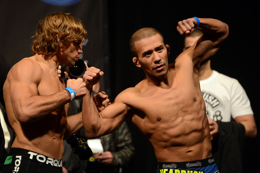 . UFC fighters  Urijah Faber and Ivan Menjivar during weigh-ins for UFC 157 Rousey vs Carmouche at the Honda Center in Anaheim Friday, February  22, 2013.  (Hans Gutknecht/Staff Photographer)