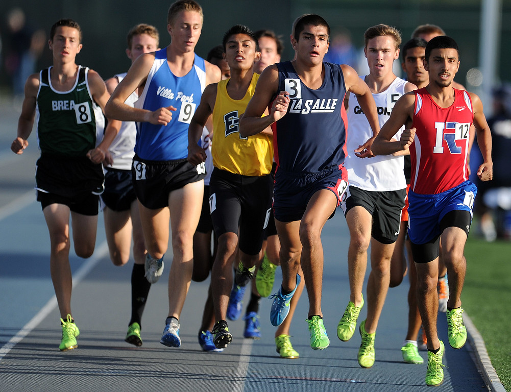 . La Salle\'s Daniel De La Torre in the 1600 meter race during the CIF-SS Masters Meet at Cerritos College on Friday, May 24, 2013 in Norwalk, Calif.  (Keith Birmingham Pasadena Star-News)