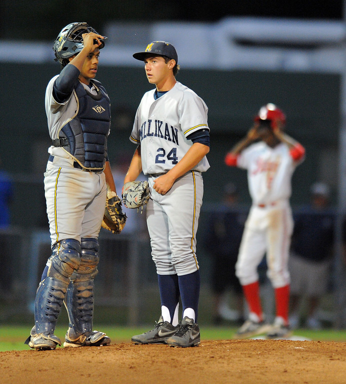 . LONG BEACH - 05/01/13 - (Photo: Scott Varley, Los Angeles Newspaper Group)  Lakewood vs Millikan baseball at Blair Field. With a runner on third in the 5th inning, Millikan catcher Giovanny Higueros chats with pticher Christopher Gutirrez.