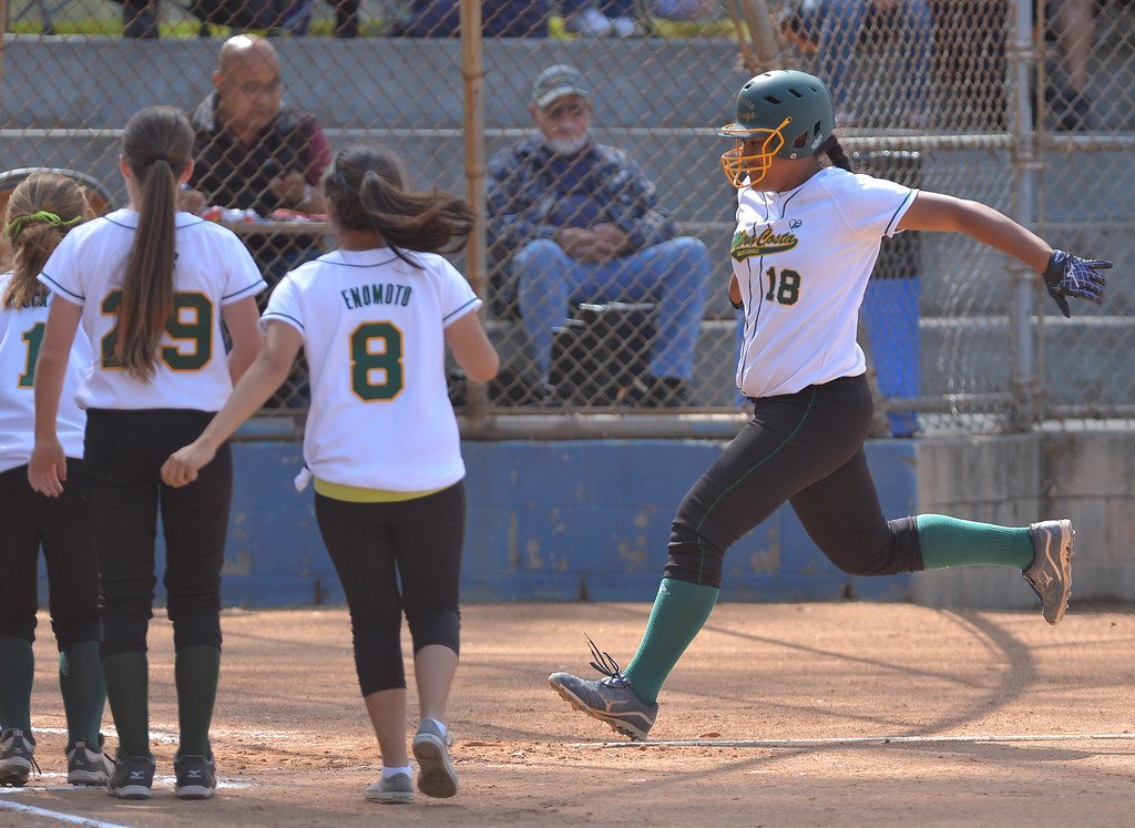 . 0517_SPT_TDB-L-MC-TORRANCE--- Torrance, CA--5/16/13--- Staff Photo: Robert Casillas  - Daily Breeze / LANG--- Mira Costa defeated Torrance High 7-1 in CIF DIV III softball playoff game at Wilson Park in Torrance. Fa Leilua jumps into home after her homer.