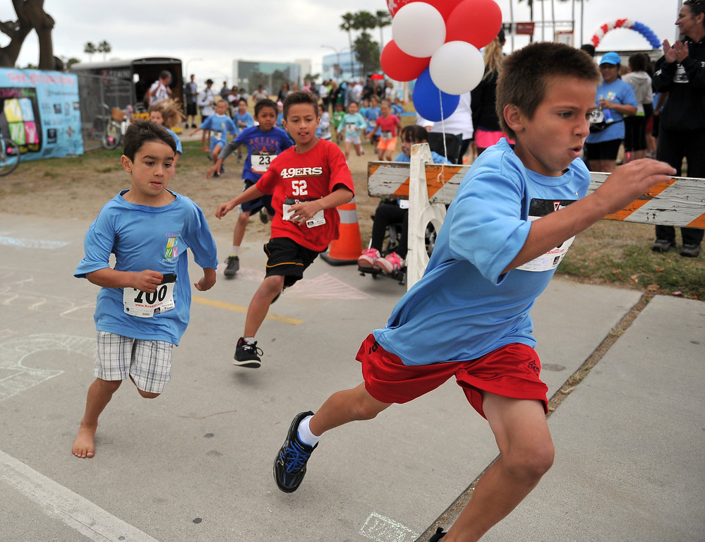. 5/25/13 - Kids take off strong for the 1-mile fun run during the Children Today\'s 5th Annual run/walk at Marina Green Park. The local non-profit, Children Today, is an organization that provides for families and children experiencing homelessness in Long Beach. They\'ve raised $33,184 and their final goal is $50,000. Photo by Brittany Murray / Staff Photographer