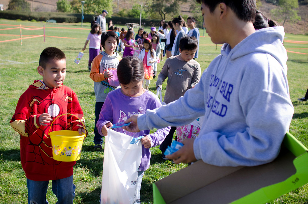 . Children wait in line to receive different candies at City of Diamond Bar\'s Easter Egg Hunt, hosted by the Diamond Bar Breakfast Lions Club at Pantera Park, in Diamond Bar, Calif., Saturday, March 30, 2013.Children were handed Easter eggs, prizes and candy were made available to children. (SGVN/Correspondent photo by Anibal Ortiz)