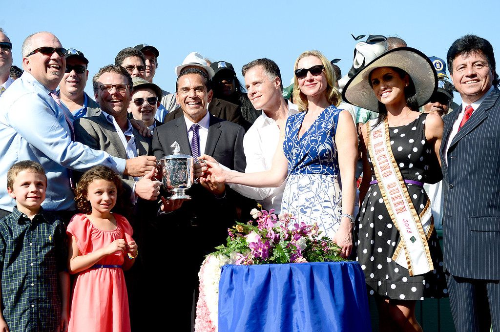 Description of . Los Angeles City Mayor Antonio Villaraigosa hands out the Santa Anita Derby cup after Goldencents win Saturday, April 6, 2013 at Santa Anita Park in Arcadia. Goldencents will now race in the Kentucky Derby. (SGVN/Staff Photo by Sarah Reingewirtz)