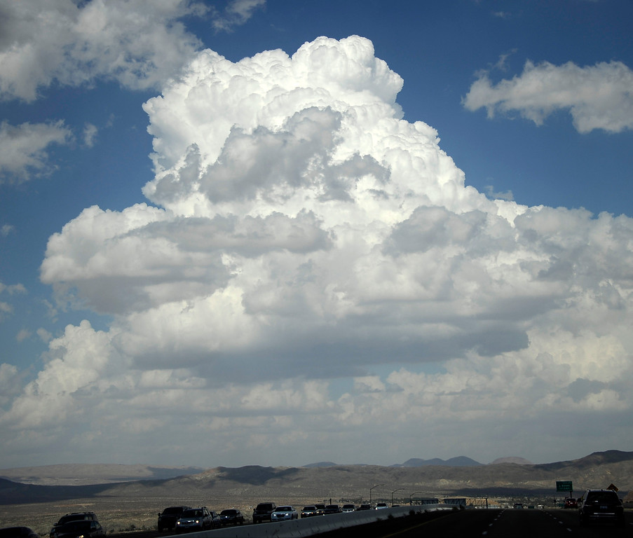 Description of . Huge monsoon storm clouds form over Barstow CA in the high deserts today Sunday. Aug 25,2013. Photo by Gene Blevins/LA Daily News