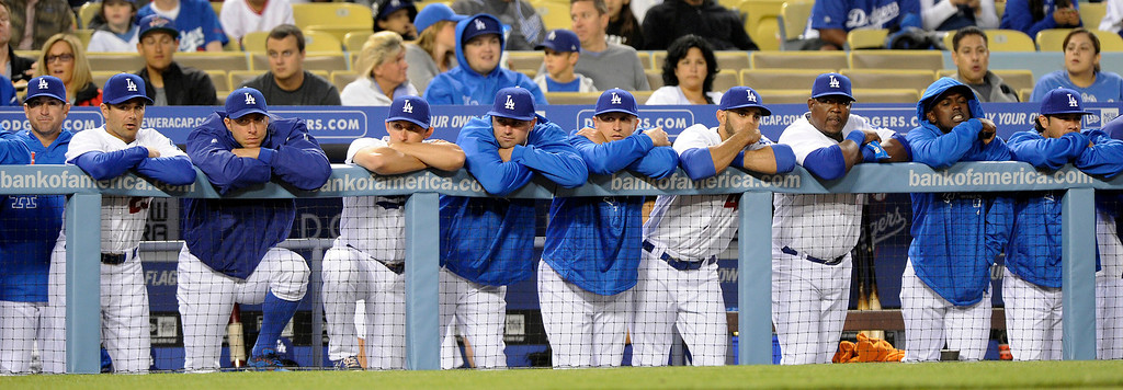 . Dodger players watch the game against the Angels from the dugout, Friday, March 29, 2013, at Dodger Stadium. (Michael Owen Baker/Staff Photographer)
