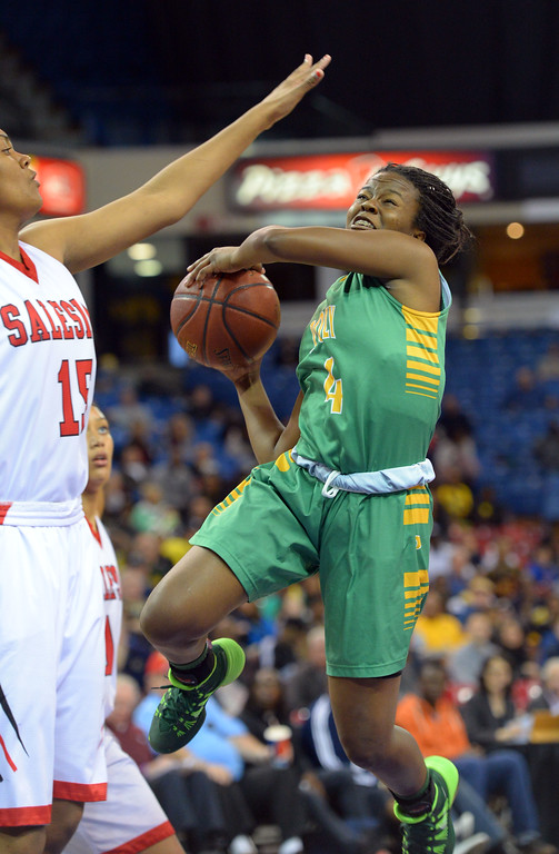 . Poly\'s Tania Lamb shoots around Salesian\'s Zoe Correal at Sleep Train Arena in Sacramento, CA on Saturday, March 29, 2014. Long Beach Poly vs Salesian in the CIF Open Div girls basketball state final. 1st half. (Photo by Scott Varley, Daily Breeze)