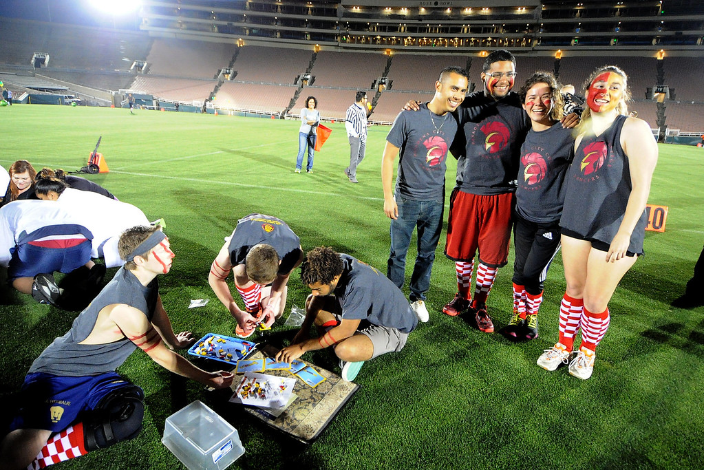 Description of . Pasadena City College team member pose for a picture as their ten members build their lego car during the the 2013 Collegiate Field Tournament at the Rose Bowl on Friday, April 5, 2013 in Pasadena, Calif.  (Keith Birmingham Pasadena Star-News)