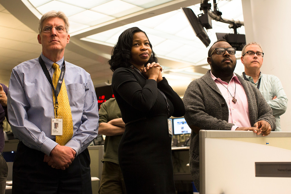 . Members of the Associated Press Headquarters newsroom await the announcement of the 2013 Pulitzer Prize awardees, Monday, April 15, 2013, in New York. Associated Press photographers Rodrigo Abd, Manu Brabo, Narciso Contreras, Khalil Hamra, and Muhammed Muheisen won the 2013 Pulitzer Prize for Breaking News Photography for their work covering the Syrian civil war. (AP Photo/John Minchillo)