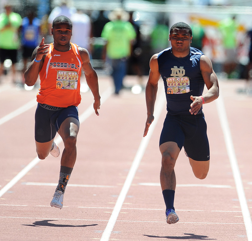 Description of . Khalfani Muhammad, right, of Notre Dame wins the 100 meter dash Invitational High School during the Mt. SAC Relays in Hilmer Lodge Stadium on the campus of Mt. San Antonio College on Saturday, April 20, 2012 in Walnut, Calif.    (Keith Birmingham/Pasadena Star-News)