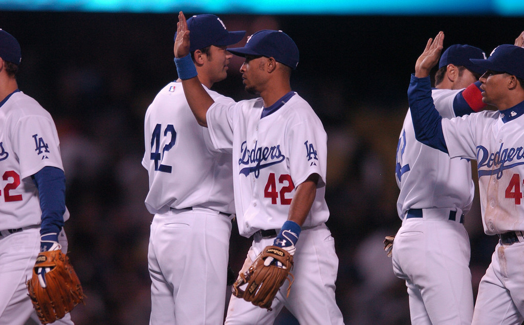 Description of . The Dodgers\' Wilson Valdez, center, congratulates teammates after beating  the San Diego Padres 9-3 at Dodger Stadium during Jackie Robinson Day, Sunday April 15, 2007. (Michael Owen Baker/Los Angeles Daily News)