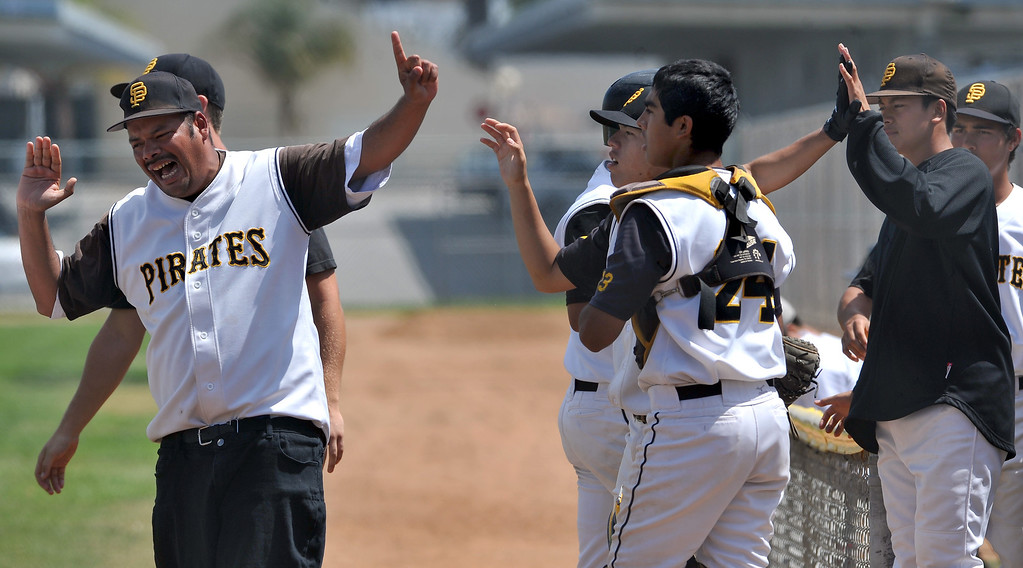 . 4/6/13 - San Pedro High School dugout during cheers the win in a non-league game against Arleta High School on Saturday morning at Harbor City College, final score 4-2. Photo by Brittany Murray / Staff Photographer