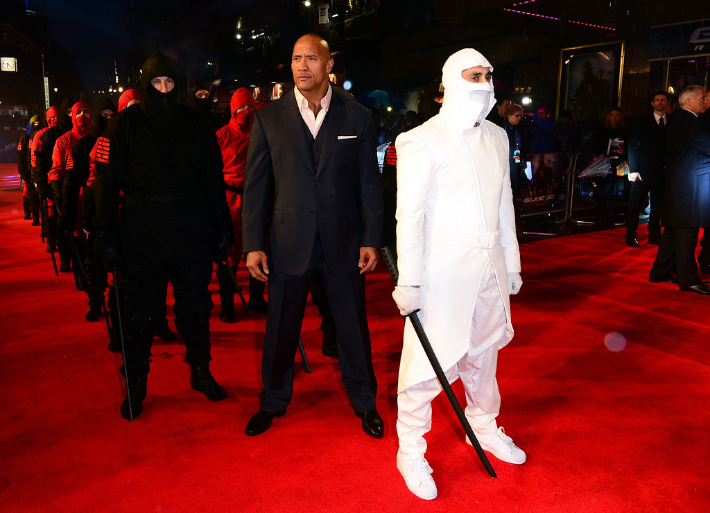 ". Dwayne Johnson arrives at the British premiere of ""G.I. Joe: Retaliation\"" at a cinema in Leicester Square, London, Monday, March 18, 2013. (Photo by Jon Furniss/Invision/AP)"