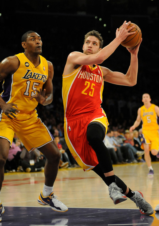 . Rockets#25 Chandler Parsons drives the lane against Lakers#15 Metta World Peace in the first quarter. The Lakers faced the Houston Rockets in the final home game of the year at Staples Center in Los Angeles, CA 4/17/2013(John McCoy/Staff Photographer