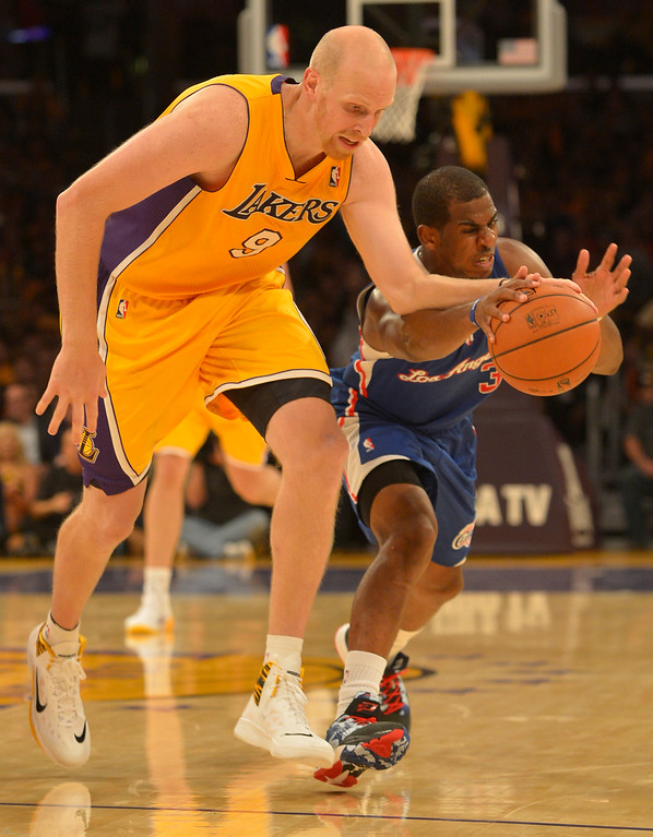 . Lakers#9 Chris Kaman has the ball stolen by Clippers#3 Chris Paul in the 4th. The Los Angeles Lakers defeated the Clippers 116 to 103 in the opening game of the season at Staples Center. Los Angeles, CA. 10/29/2013. photo by (John McCoy/Los Angeles Daily News)