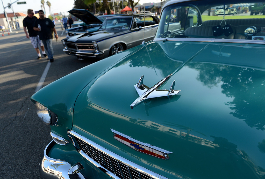 Description of . Classic cars line the street for the Route 66 Cruisin' Reunion on Euclid Ave in Ontario, CA Friday, September 20, 2013. (Jennifer Cappuccio Maher/Inland Valley Daily Bulletin)