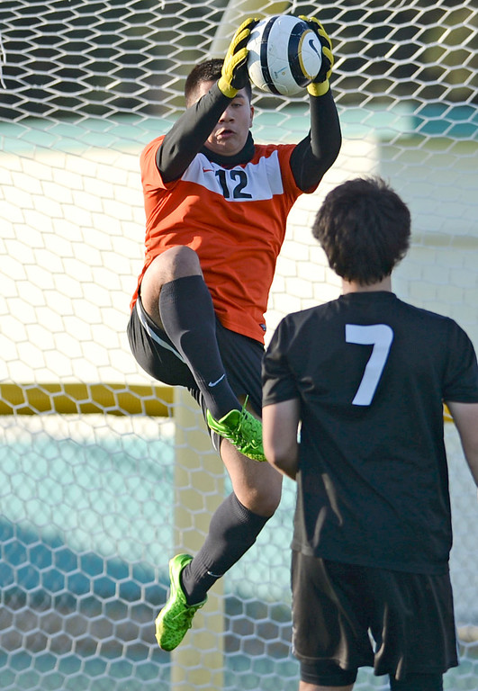 . Narbonne keeper Daniel Lepe (12) makes a stop on San Pedro in a Marine League boys soccer game Wednesday, February 12, 2014, Harbor City, CA.  Narbonne won 2-0 and seals the league title. Photo by Steve McCrank/Daily Breeze
