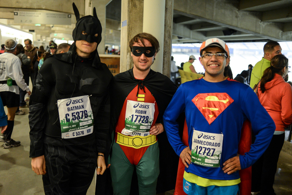 . Super hero runners, l to r; Patrick Teague and Robert Handily from the Uk and Jamie Corado from Pamoma before the start of the LA Marathon Sunday at Dodger Stadium. Photo by David Crane/Staff Photographer