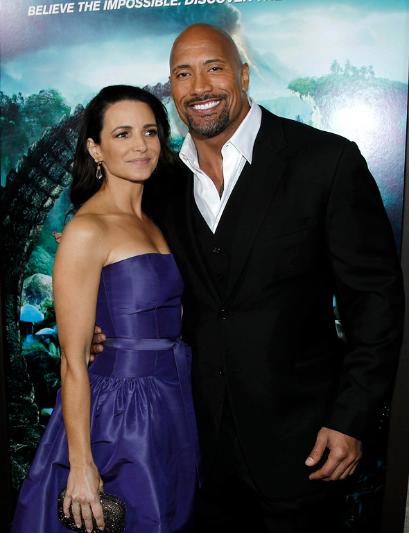 ". Cast members Dwayne ""The Rock\"" Johnson, right, and Kristin Davis pose together at the premiere of \""Journey 2: The Mysterious Island\"" in Los Angeles, Thursday, Feb. 2, 2011.  \""Journey 2: The Mysterious Island\"" will be released Feb. 10, 2011.  (AP Photo/Matt Sayles)"
